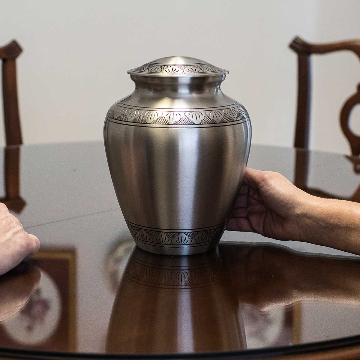 Silver urn funeral cremation options